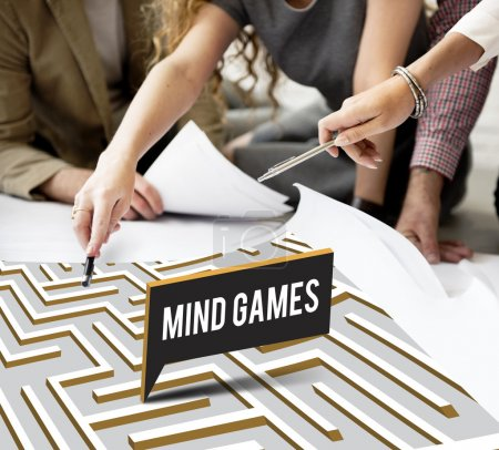 designers working with poster and mind games