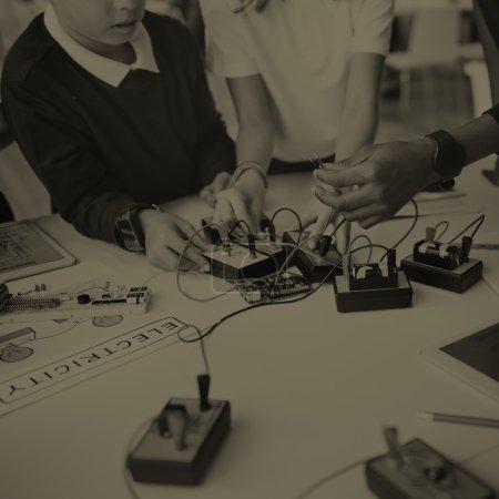 children doing Eletronic Experiment