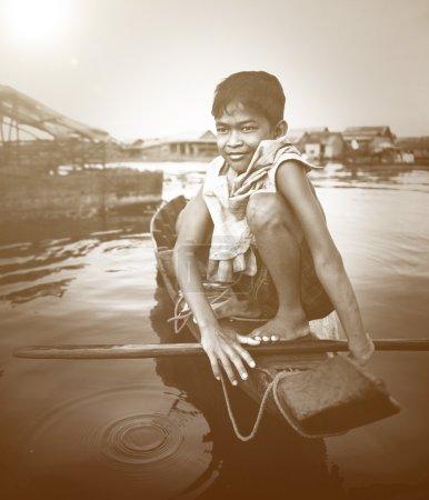 Boy Taveling on Boat