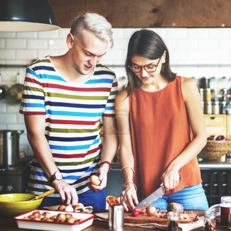 portrait of happy couple in kitchen
