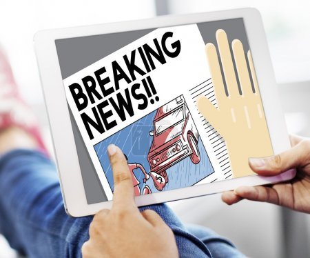 digital tablet with breaking news