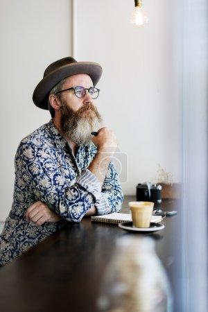 Stylish hipster man writing something