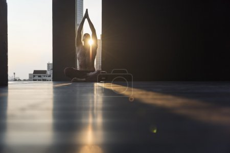 active man practicing yoga