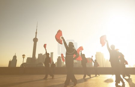 silhouette people dansing at street