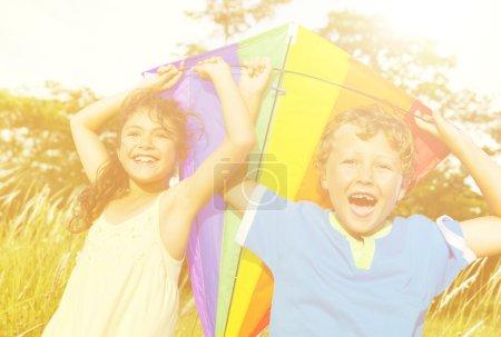 Cheerful Children Playing with Kite