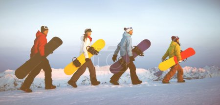 Snowboarders on top of mountain