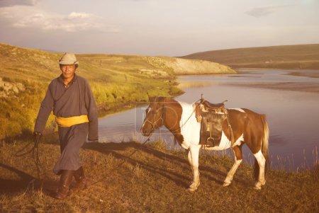 Man Bringing The Horse