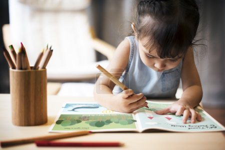 Girl painting on Coloring-book