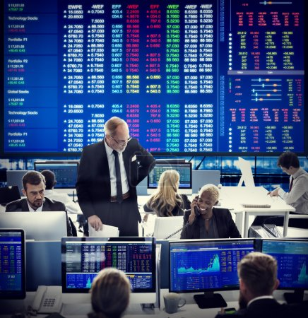 Business workers and stock market