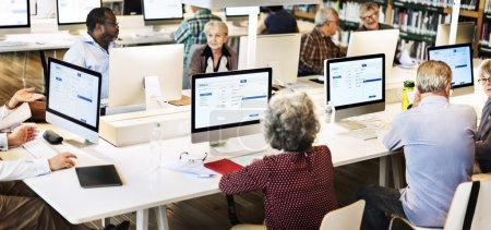 senior adult students in computer class
