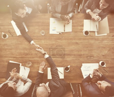 businesspeople working at negotiating table