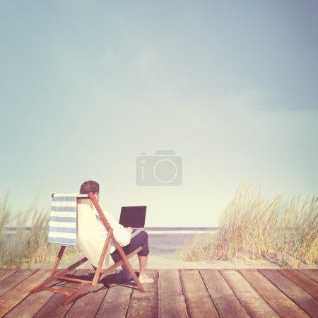 Businessman Staying Alone at beach