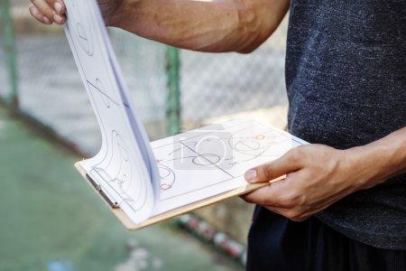 Basketballer Holding Game Plan