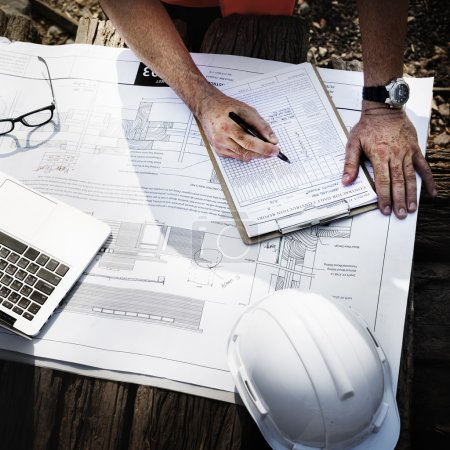 Construction Worker Looking at Building plan