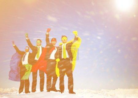 Business Superheros in Winter Snow