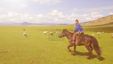 Boy tilting head to his horse