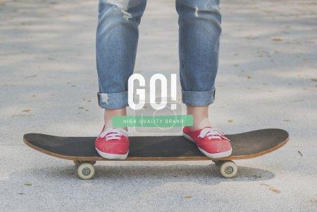 womans legs on skateboard
