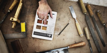 Craftsman working with Tablet