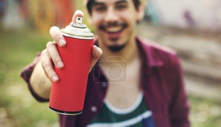 Man holding Spray for Graffiti