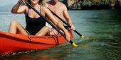 Couple Kayaking in ocean
