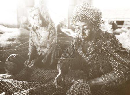 Women repairing fishing nets