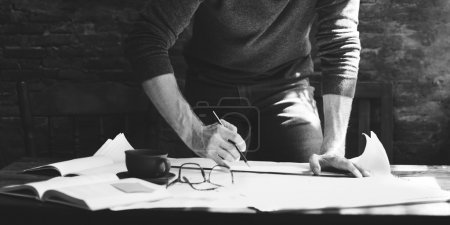 man working with documents
