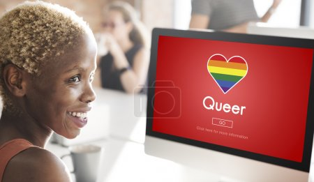businesswoman working on computer with queer