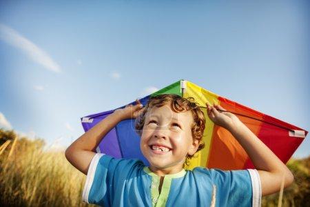 Boy Playing Kite Outdoors