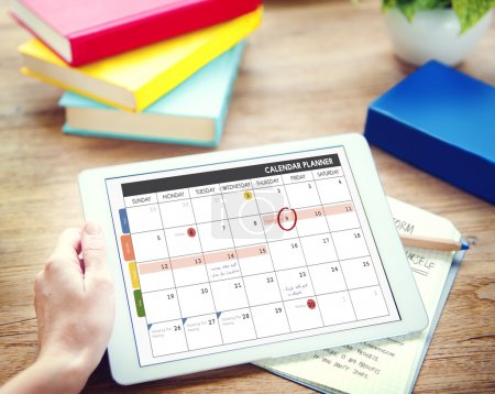 Man using tablet and Calendar Concept