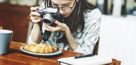 Girl Photographing Food
