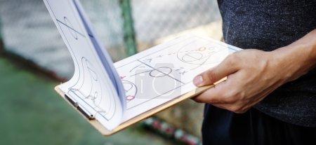 Basketballer looking on Game Plan