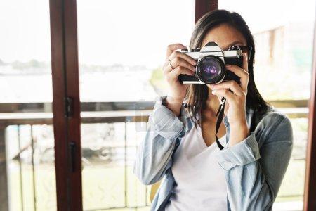 Woman making photo by camera