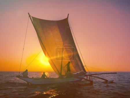 Fishermen on Catamaran at Sunset