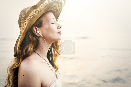 Woman listening music and dreaming