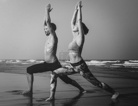 Couple doing Yoga on Beach