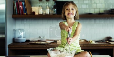 girl kneading dough for cookies