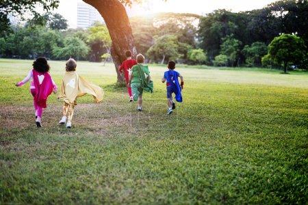 Superhero Children playing outdoors