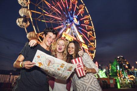 Friends have fun in Amusement Park