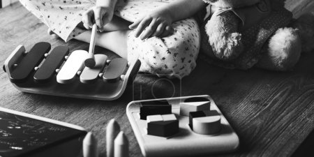 Kid Playing with Xylophone Toy