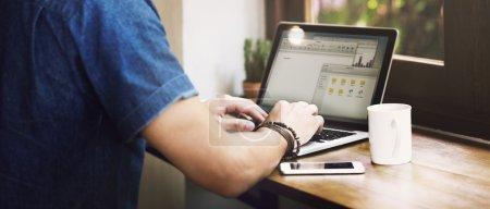 Casual Man Browsing laptop