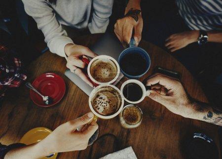 Friends drinking coffee in bar