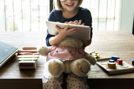 Little Girl with digital tablet