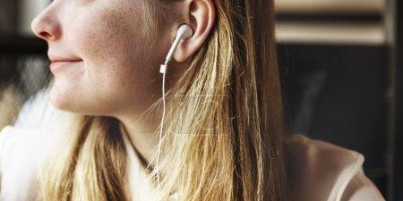 Girl listening music in earphones
