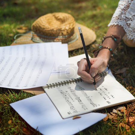 girl writing a song