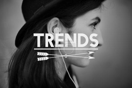 Young girl listening music in earphones