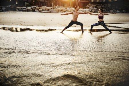 people doing Yoga exercises