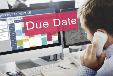 businessman working on computer with Due Date
