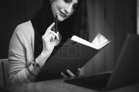 Woman reading notebook