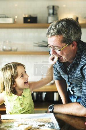 father with daughter in kitchen