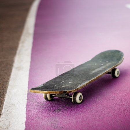 Old Skateboard on floor